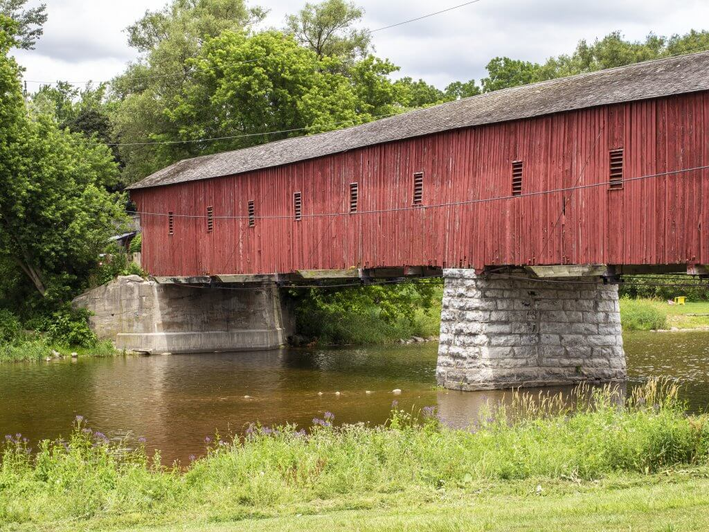 Wide view of the West Montrose Covered Kissing Bridge